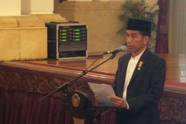 Presiden Joko Widodo dalam acara peringatan Nuzulul Qur'an di Istana Negara, Jumat (3/7/2015).