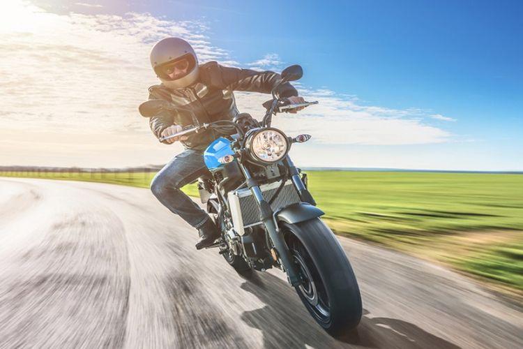 Ilustrasi pengendara sepeda motor.