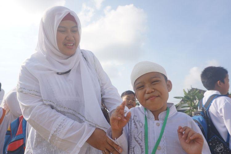 Ariel penyandang autis saat manasik haji Kamis (7/9/2017)
