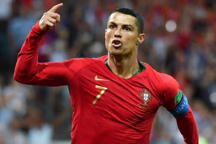 Cristiano Ronaldo merayakan gol Portugal ke gawang Spanyol pada pertandingan Grup B Piala Dunia 2018, 15 Juni 2018.
