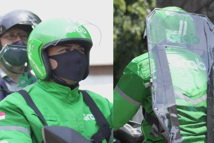 Para mitra pengemudi Grab dibekali alat pelindungi GrabBike Protect. Alat ini merupakan partisi plastik yang dirancang untuk meminimalkan terjadinya kontak antara penumpang dengan pengemudi.