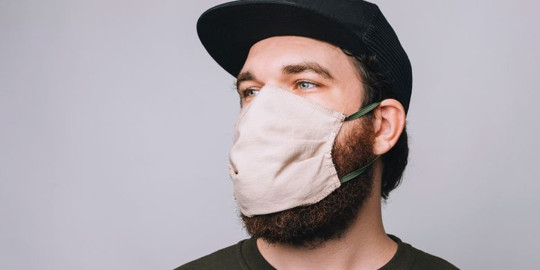 Ilustrasi orang berjenggot menggunakan masker