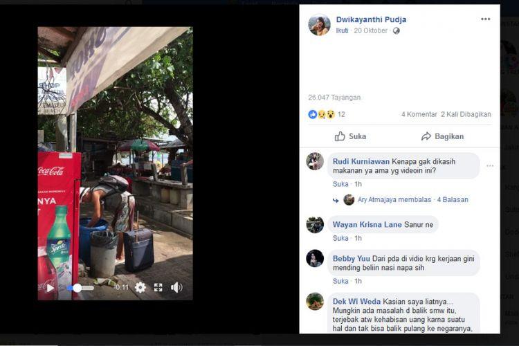 Turis asing tampak mengais di tong sampah di Bali.