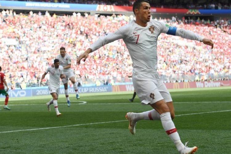 Kapten Portugal, Cristiano Ronaldo, merayakan gol sundulannya ke gawang Maroko pada pertandingan Grup B Piala Dunia 2018 di Stadion Luzhniki, 20 Juni 2018.