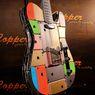 Gitar Unik Ini Dibuat dari Ratusan iPhone