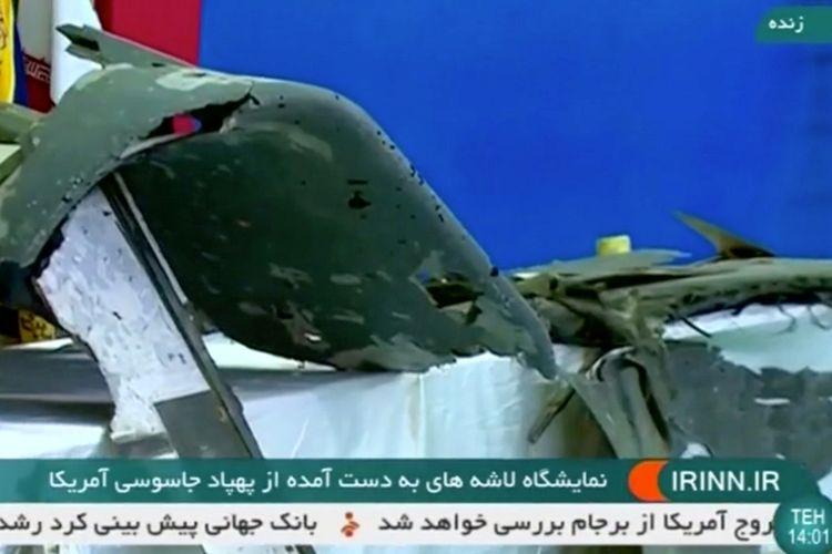 Inilah penampakan serpihan drone RQ-4A Global Hawk milik Amerika Serikat yang diklaim ditembak jatuh oleh Iran dalam tayangan bertanggal 21 juni 2019 di sebuah lokasi yang dirahasiakan.