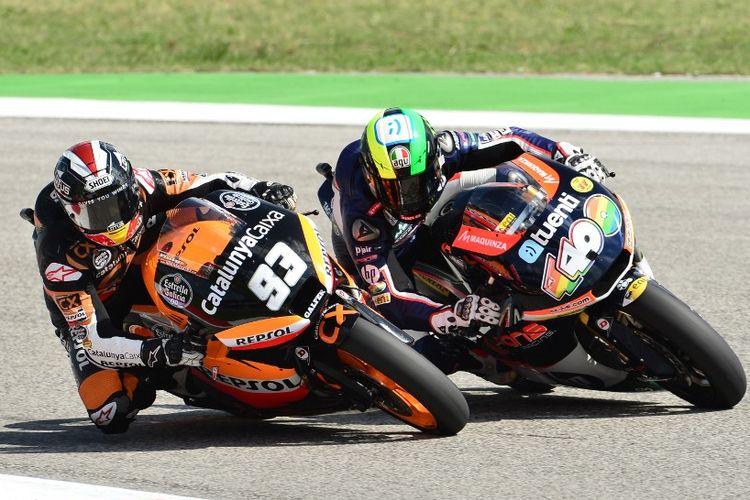 Marc Marquez dan Pol Espargaro di kelas Moto2. AFP PHOTO / GIUSEPPE CACACE (Photo by GIUSEPPE CACACE / AFP)