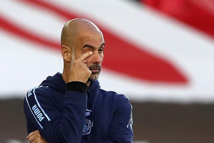 Ekspresi Pep Guardiola dalam laga Southampton vs Manchester City pada pekan ke-33 Liga Inggris 2019-2020.