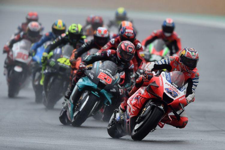 Jack Miller saat berlaga di MotoGP Le Mans. (Photo by JEAN-FRANCOIS MONIER / AFP)