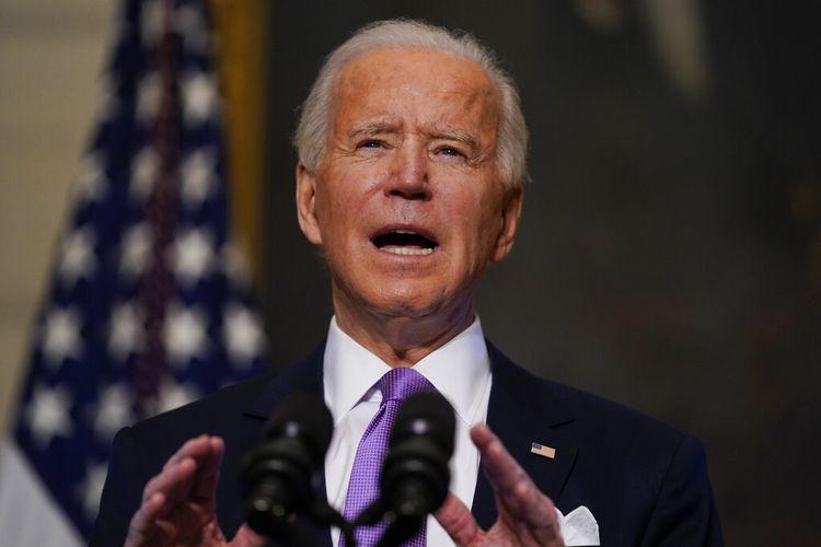 Presiden AS <a href='https://manado.tribunnews.com/tag/joe-biden' title='JoeBiden'>JoeBiden</a> menyampaikan sambutan tentang Covid-19, di Ruang Makan Negara Gedung Putih, Selasa (16/1/2021), di Washington DC.