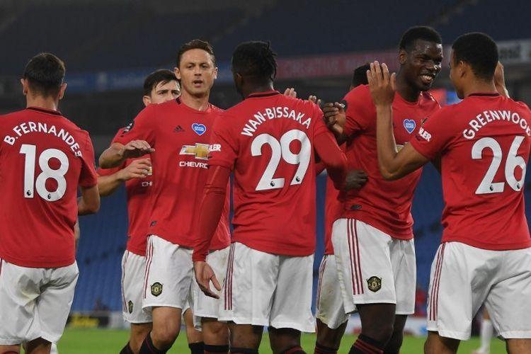 Para pemain Manchester United merayakan gol Mason Greenwood dalam pertandingan melawan Brighton pada pekan ke-32 Liga Inggris di Stadion Falmer, Rabu (1/7/2020) dini hari WIB.