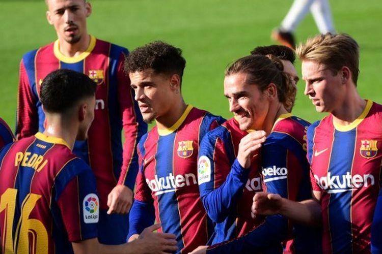 Skuad Barcelona saat merayakan gol ke gawang Osasuna pada laga lanjutan pekan ke-11 Liga Spanyol di Stadion Camp Nou, Minggu (29/11/2020) malam WIB.