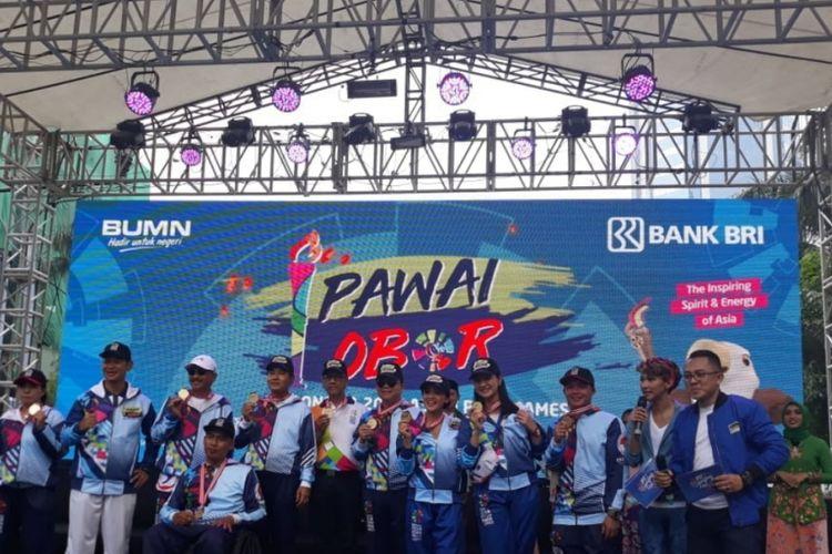 Obor Asian Paragames saat tiba di Jalan Imam Bonjol, Jakarta Pusat, Minggu (30/9/2018).