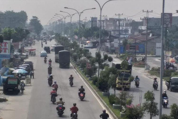 Kondisi kabut asap dampak karhutla yang menyelimuti Kota Pekanbaru, Riau, Rabu (31/7/2019).