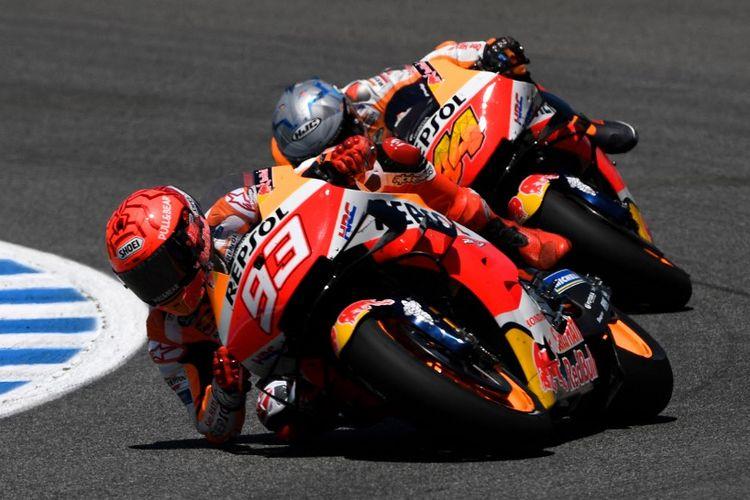 Marc Marquez saat balapan pada MotoGP Spanyol 2021. (Photo by PIERRE-PHILIPPE MARCOU / AFP)