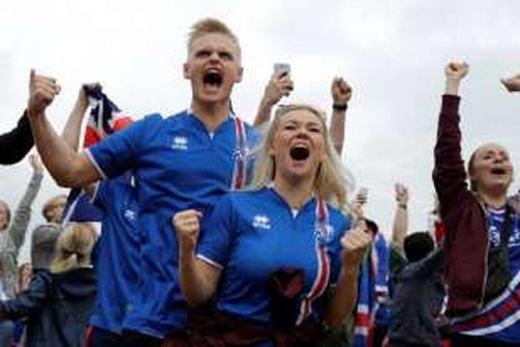 Reaksi kegembiraan para pendukung Islandia saat menyaksikan laga Piala Eropa kontra Hungaria di fan zone Paris, Perancis, pada 18 Juni 2016.
