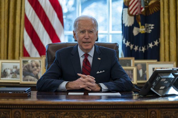 Presiden AS Joe Biden menyampaikan sambutan tentang perawatan kesehatan, di Ruang Oval Gedung Putih, Kamis, 28 Januari 2021, di Washington.