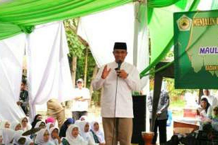 Calon gubernur DKI Jakarta Anies Baswedan menghadiri acara maulid nabi di Perum Green Garden, Rorotan, Cilincing, Jakarta Utara, Sabtu (3/12/2016).