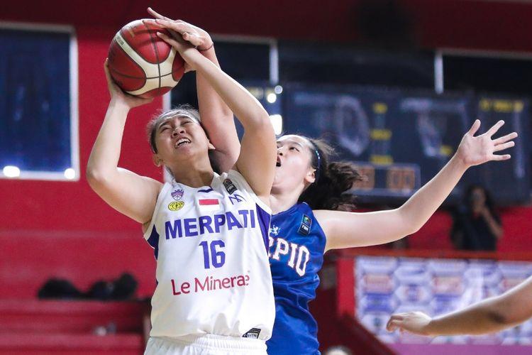 Klub basket putri Merpati Bali punya cara unik saat mengungguli lawannya, Scorpio Jakarta dengan angka kemenangan setengah bola, 47-46.