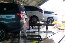 Dampak Malas Cuci Mobil Usai Terkena Hujan