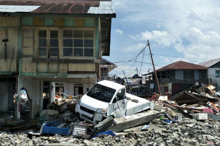 Dampak kerusakan akibat gempa Donggala dan tsunami Palu, Sulawesi Tengah, pada Jumat (28/9/2018), di Pelabuhan Wani 2, Kecamatan Tanatopea, Kabupaten Donggala, Sulawesi Tengah, Selasa (2/10/2018).