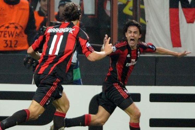 Filippo Inzaghi dan Zlatan Ibrahimovic merayakan gol untuk AC Milan dalam sebuah laga Liga Champions di Stadion San Siro, 3 November 2010.