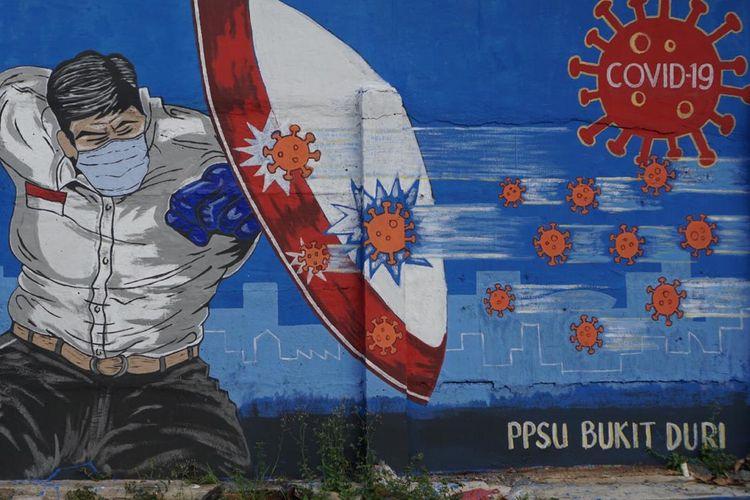 Gambar mural di Bukit Duri, Tebet, Jakarta.