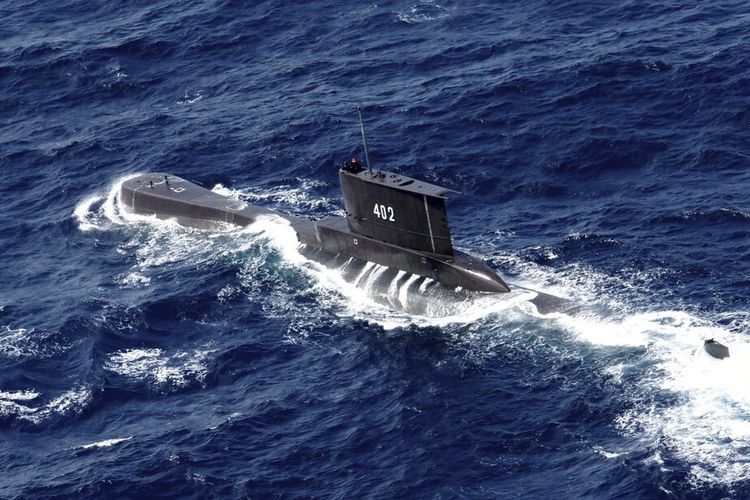Indonesian Navy submarine KRI Nanggala sails in the waters off Tuban, East Java, Indonesia, as seen in this aerial photo taken from Indonesian Navy helicopter of 400 Air Squadron, in this Monday, Oct. 6, 2014 photo. Indonesia's navy is searching for the submarine that went missing north of the resort island of Bali with a number of people on board, the military said Wednesday. (AP Photo/Eric Ireng)