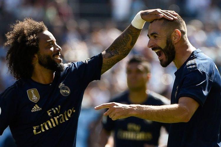 Marcelo merayakan gol Karim Benzema pada pertandingan Celta Vigo vs Real Madrid dalam lanjutan La Liga Spanyol di Stadion Balaidos, 17 Agustus 2019.
