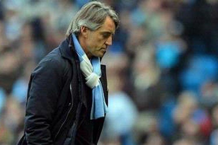 Manajer Roberto Mancini akhirnya dipecat Manchester City, Selasa (14/5/2013).