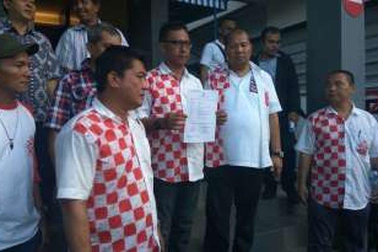 Solidaritas Merah Putih (Solmet) seusai membuat laporan polisi di Mapolda Metro Jaya, Selasa (10/1/2017).