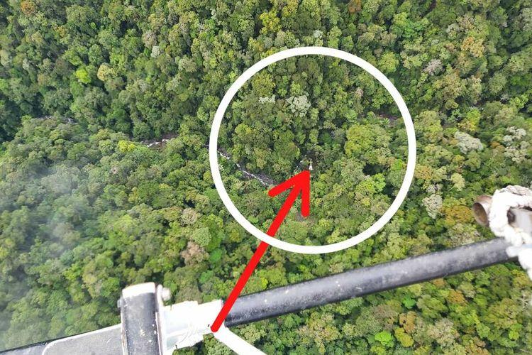 tampak yang dilingkari merah merupakan lokasi pendaratan darurat helikopter milik PT. NUH yang hilang kontak di Paniai, sejak Kamis (17/9/2020), Papua, Jumat (18/9/2020)