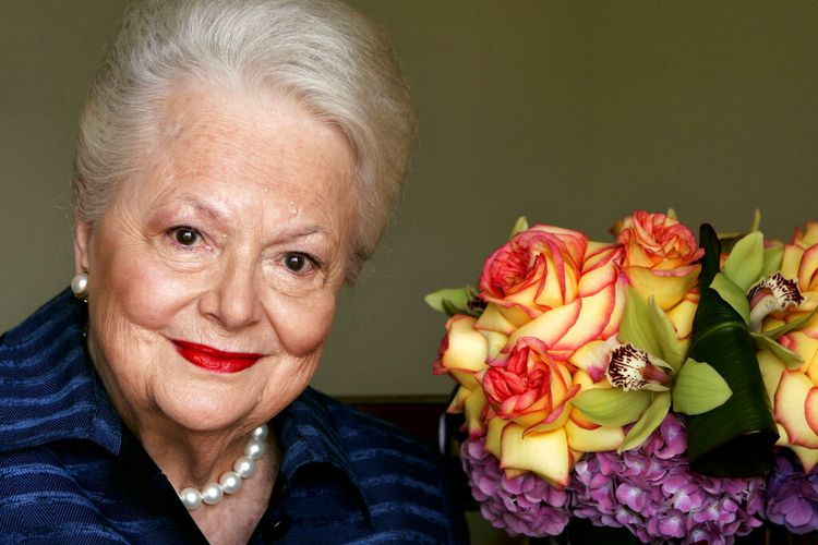 FILE - In this file photo dated Wednesday, Sept. 15, 2004, Actress Olivia de Havilland, who played the doomed Southern belle Melanie in Gone With the Wind, poses for a photograph, in Los Angeles, USA.  Olivia de Havilland, Oscar-winning actress has died, aged 104 in Paris,  publicist says Sunday July 26, 2020. (AP Photo/Kevork Djansezian, FILE)