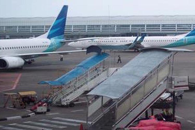 Pesawat Garuda Indonesia siap lepas landas di Bandara Soekarno Hatta, Cengkareng, Banten, Rabu (17/4/2013).
