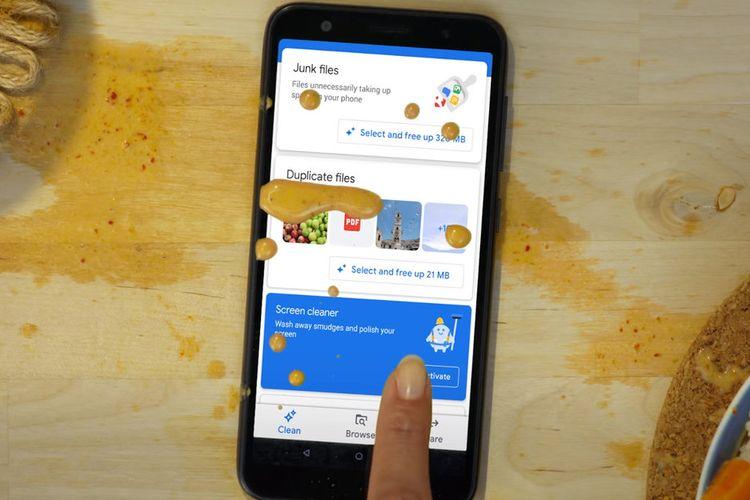 Ilustrasi tampilan depan aplikasi Files. Tampak ponsel dikotori dengan noda berwarna coklat.