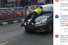 Tak Mau Diperiksa, Pengendara Kabur dengan Polisi Bergelayut di Kap Mobil