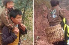 Pria Ini Setiap Hari Gendong Anaknya yang Cacat 16 Km ke Sekolah