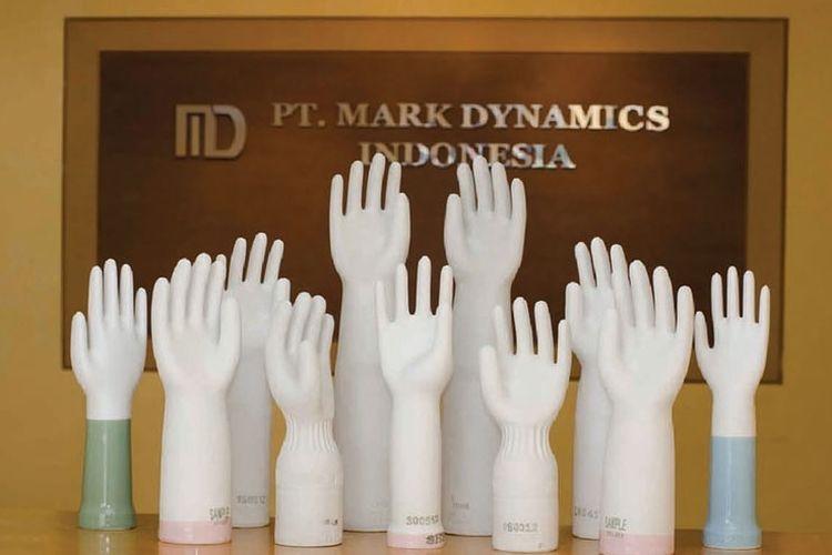 Cetakan sarung tangan produksi PT Mark Dynamics Indonesia Tbk (MARK)