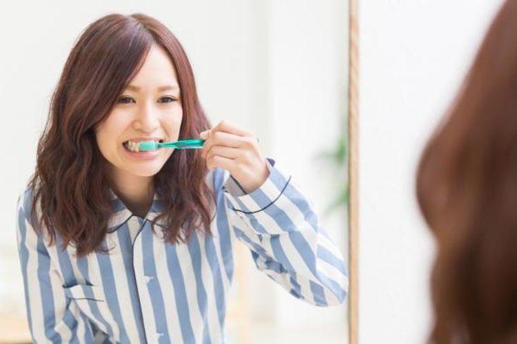 Ilustrasi menyikat gigi