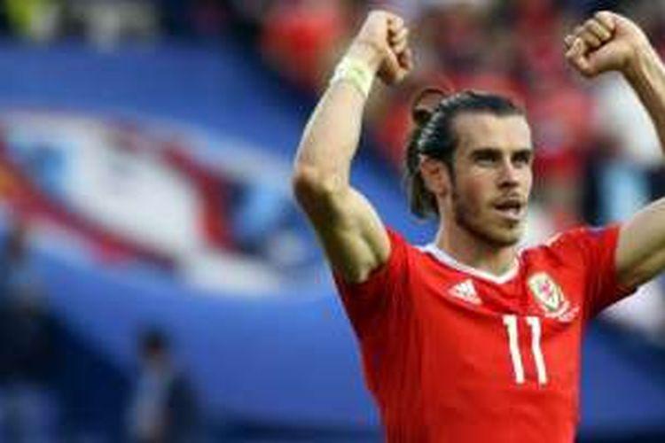 Gareth Bale merayakan kemenangan Wales atas Irlandia Utara pada babak 16 besar Piala Eropa 2016, Sabtu (25/6/2016).