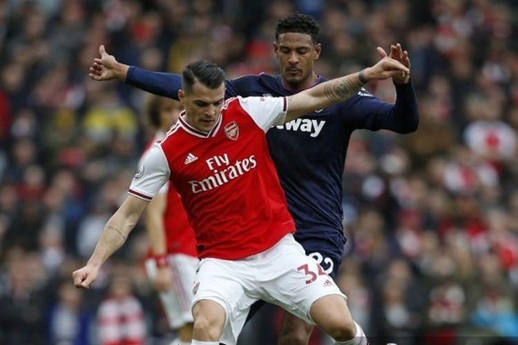 Granit Xhaka dalam laga Arsenal vs West Ham pada pekan ke-29 Liga Inggris