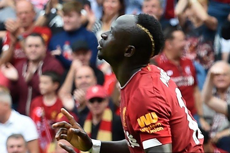 Sadio Mane merayakan golnya pada pertandingan Liverpool vs Newcastle United di Stadion Anfield dalam lanjutan Liga Inggris, 14 September 2019.
