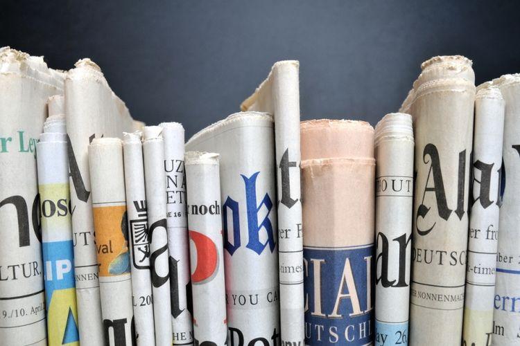 Ilustrasi surat kabar yang memuat berita