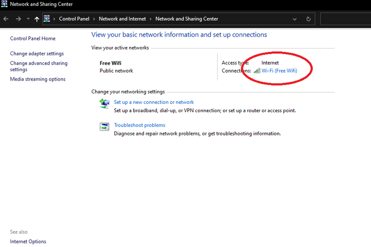 Opsi Wifi Settings pada menu pengaturan Network and Sharing Center.