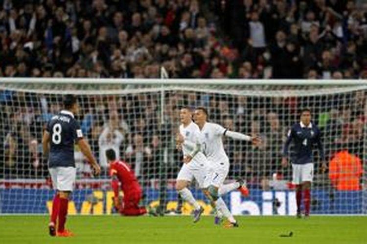 Pemain muda Inggris, Delle Alli (7), merayakan golnya ke gawang Prancis pada partai uji coba di Stadion Wembley, Selasa (17/11/2015).