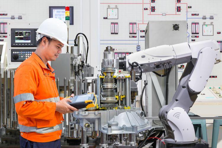 Ilustrasi pemanfaatan robot pada sistem produksi sektor manufaktur pada era industri 4.0.