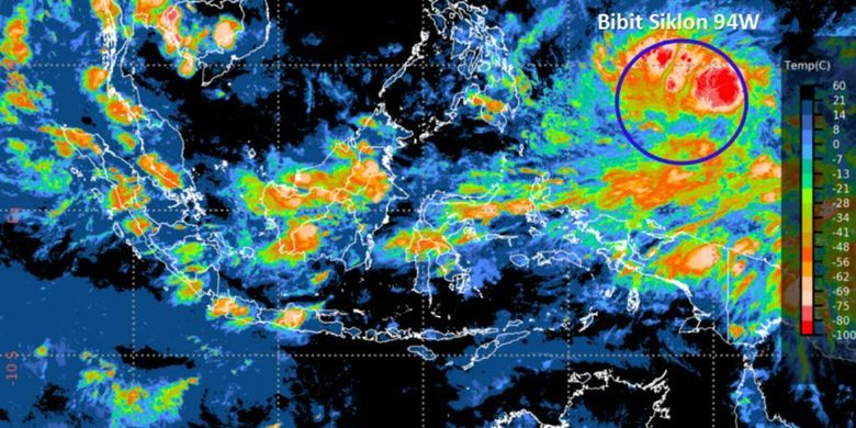 Citra satelit yang menunjukkan adanya pertumbuhan Bibit Siklon Tropis 94W (lingkaran biru) di Samudera Pasifik utara Papua, Senin (12/4).
