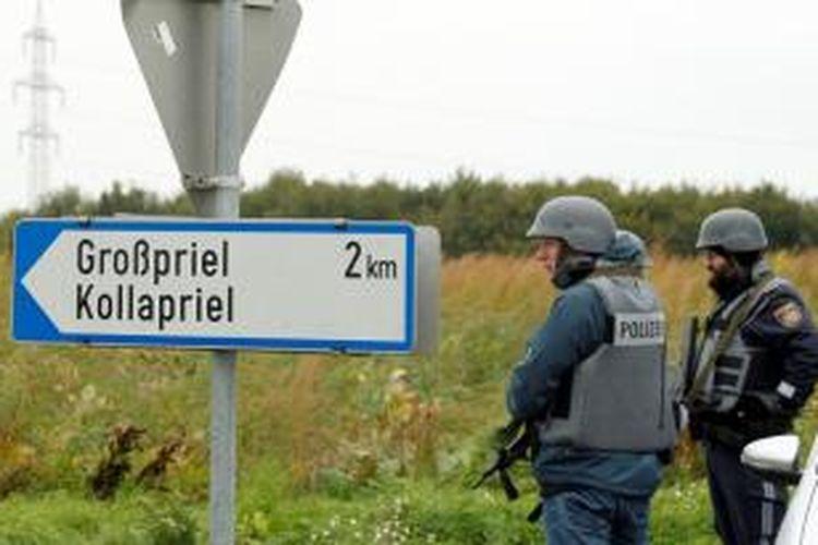 Polisi Austria mengepung sebuah peternakan yang menjadi tempat persembunyian seorang pemburu gelap yang menembak mati dua polisi dan seorang paramedis.