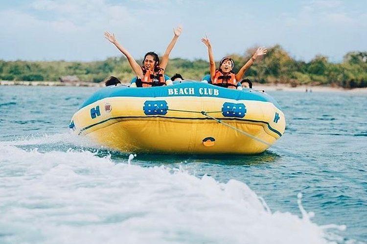 Tourists try a donut boat at Lalassa Beach Club, Tanjung Lesung, Pandeglang, Banten.