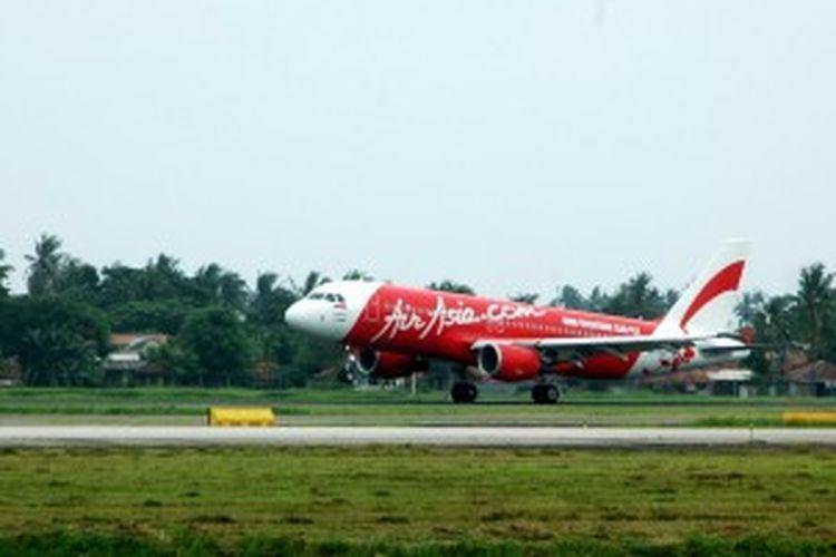 Ilustrasi - Pesawat milik maskapai penerbangan Air Asia di Terminal 3, Bandara Soekarno-Hatta, Tangerang, Rabu (2/2/2011).